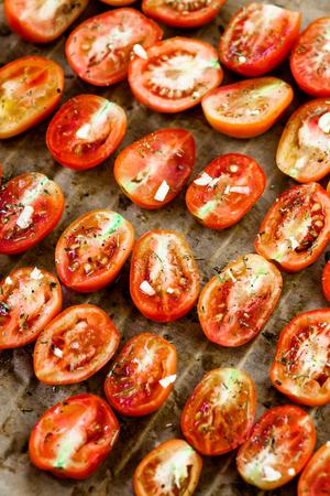 sun dried: Vegetarian food. Sun dried tomatoes with herbs and garlic. Italian food vegetables Stock Photo
