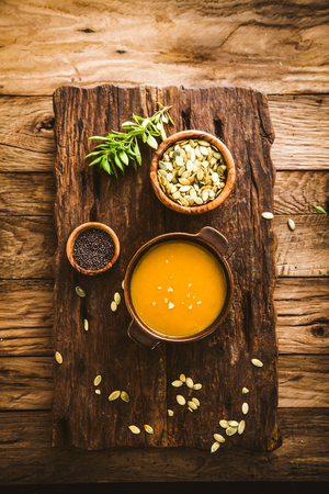 Pumpkin soup. Autumn dinner with healthy vegetable soup Stock Photo