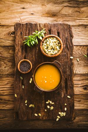 pumpkin soup: Pumpkin soup. Autumn dinner with healthy vegetable soup Stock Photo