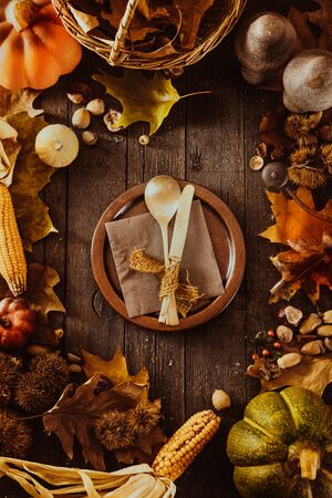 table setting: Thanksgiving dinner. Autumn fruit with plate and cutlery. Thanksgiving autumn background