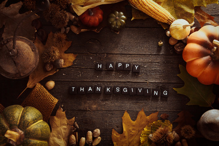 Thanksgiving background. Autumn fruit with Thanksgiving letters. Thanksgiving dinner