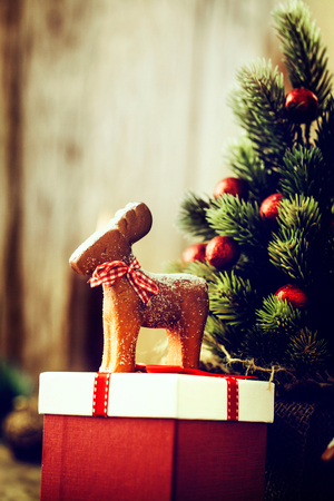 new year tree: Christmas background. Santa Claus with Christmas tree,presents and gingerbread man. Stock Photo
