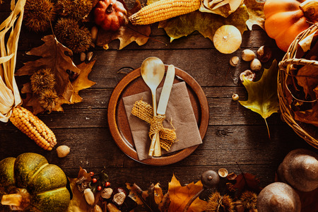 setting: Thanksgiving dinner. Autumn fruit with plate and cutlery. Thanksgiving autumn background