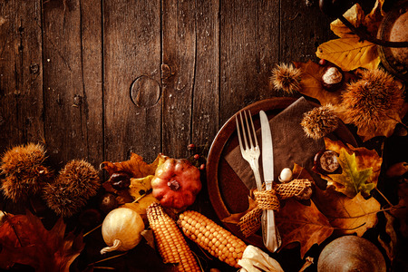 background color: Thanksgiving dinner. Autumn fruit with plate and cutlery. Thanksgiving autumn background