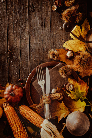 background settings: Thanksgiving dinner. Autumn fruit with plate and cutlery. Thanksgiving autumn background