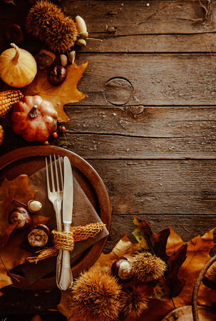 autumn colors: Thanksgiving dinner. Autumn fruit with plate and cutlery. Thanksgiving autumn background