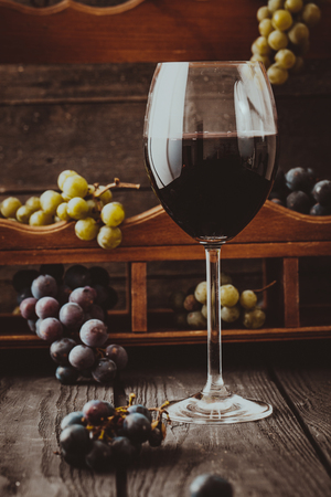 grape: Red wine with grapes. Fresh grapes on wood. Autumn fruit