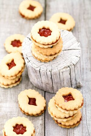 christmas baking: Christmas baking. Linzer cookies with jam