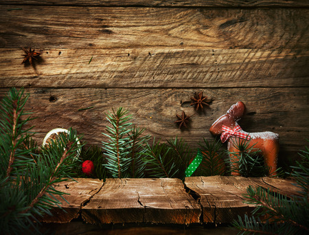 Christmas holiday background with empty wooden deck table over Christmas ornaments. Ready for product montage. Rustic vintage Xmas background.