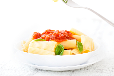 pasta sauce: Pasta with Tomato Sauce and Basil on a Fork. Italian food. Mediterranean cuisine