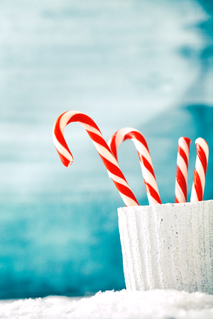 xmass: Candy canes. Christmas background with candies. Xmass sweets.