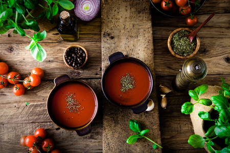 rustic kitchen: Tomato soup with olive oil and basil. Vegetarian food.