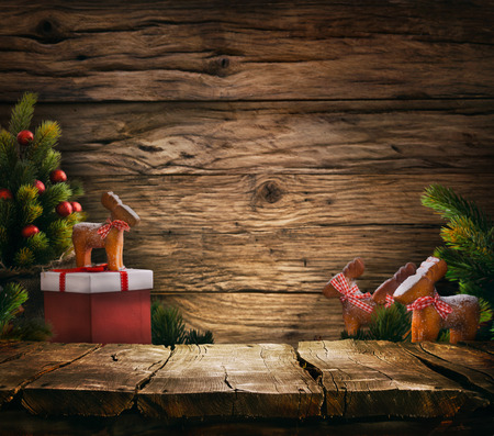 Christmas background. Empty table for your montage. Xmass tree on wood. Space for text Archivio Fotografico