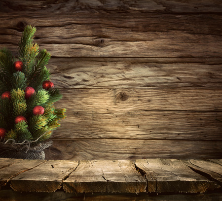 Christmas background. Empty table for your montage. Xmass tree on wood. Space for text Standard-Bild