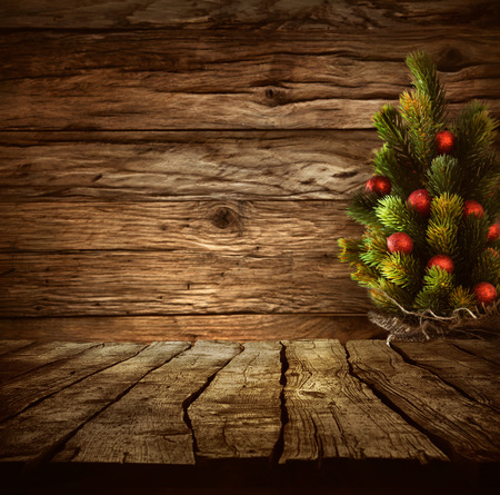 xmass: Christmas background. Empty table for your montage. Xmass tree on wood. Space for text Stock Photo