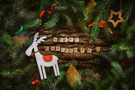 Merry Christmas. Christmas greeting card with rustic wood and ornaments. Xmas backgroud.