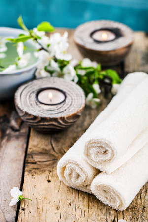 dayspa: Spa and wellness setting with natural soap, candles and towel. Beige dayspa nature set with copyspace Stock Photo