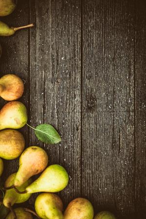 pear: Fruit background. Fresh organic pears on old wood. Pear autumn harvest