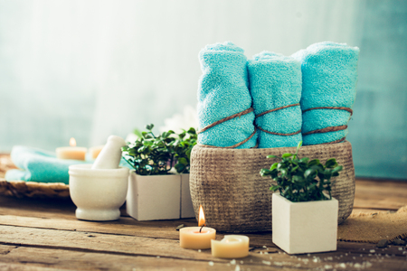 towel: Spa and wellness setting with flowers and towels. Dayspa nature products