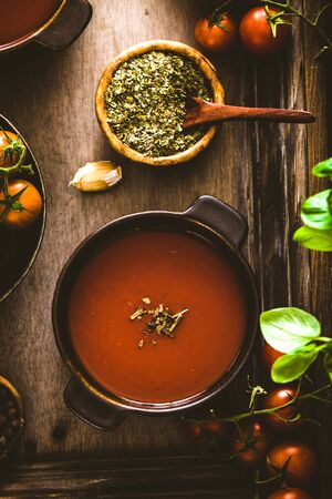 comfort food: Tomato soup. Homemade tomato soup with tomatoes, herbs and spices. Comfort food.
