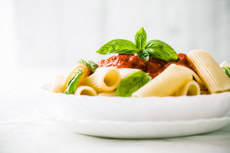 Pasta with Tomato Sauce and Basil. Italian food. Mediterranean cuisine Stock Photo