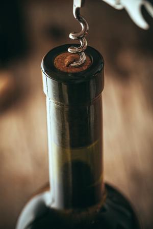 Wine. Glass of white wine in wine cellar. Old white wine on wood. Фото со стока