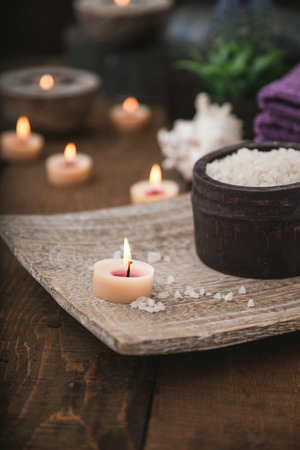 dayspa: Spa and wellness setting with natural bath salt, candles, towels and flower. Wooden dayspa nature set Stock Photo