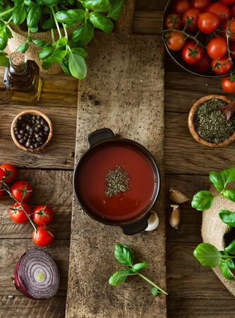vegetarian food: Tomato soup with olive oil and basil. Vegetarian food.