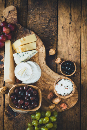 variety: Cheese variety. Food background.  Fresh ingredients on wood