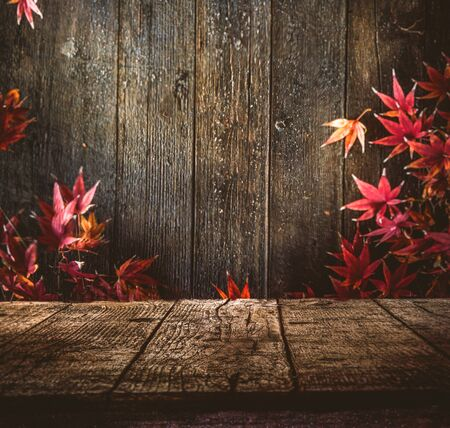 Wooden table. Autumn design with leaves and empty display. Space for your montage. Season fall background