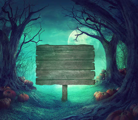 Halloween background. Spooky forest with dead trees and pumpkins. Halloween design with pumpkins. Archivio Fotografico
