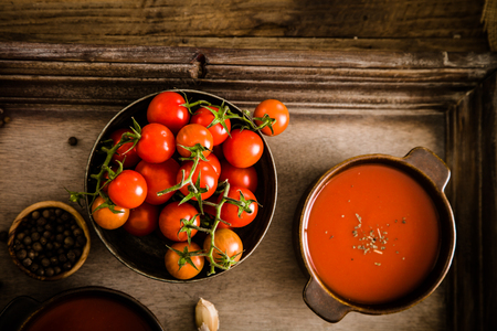 Tomato soup. Homemade tomato soup with tomatoes, herbs and spices. Comfort food.