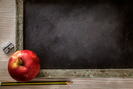 School objects for students. Chalkboard, pencils, crayons and apple