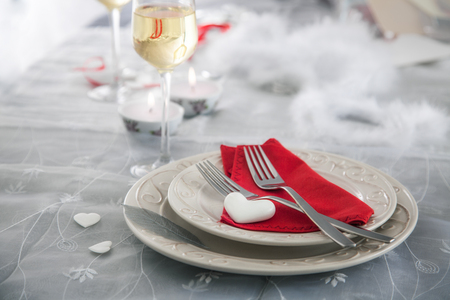 Valentines day table. Plate with two forks and hearts. Valentines day dinner.St. Valentine table setting