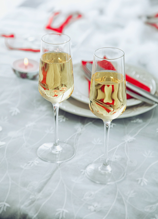 Valentines day table. Champagne glasses toast. Valentines day dinner.St. Valentine table setting Stock Photo