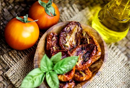 Vegetarian food. Sun dried tomatoes with herbs and garlic. Italian food vegetables Banco de Imagens