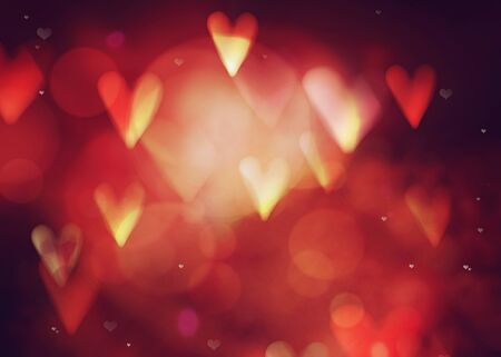Valentines day. Valentines  abstract background with hearts and bokeh. Love red background. Valentines day glittering lights Stock Photo