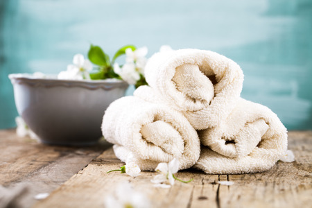 Spa and wellness setting with natural soap, candles and towel. Beige dayspa nature set with copyspace Stock Photo