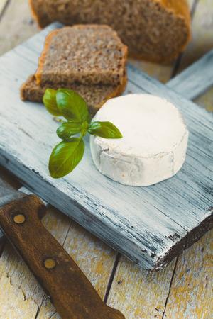 Fresh cheese on wood