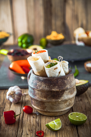 Tortilla wraps with vegetables. Mexican tortillas. Tacos with nachos and vegetables 版權商用圖片