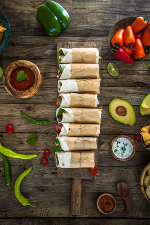 Tortilla wraps with vegetables. Mexican tortillas. Tacos with nachos and vegetables. Party finger food