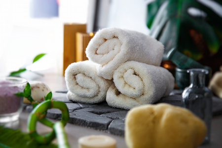 Spa and wellness. Fresh towels for spa treatment. in natural setting. Cosmetic products