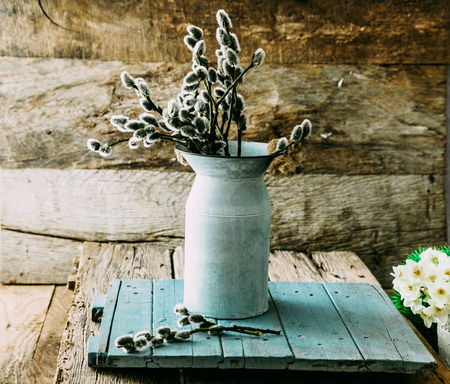Spring flowers on wood. Rustic spring setting. Stock Photo