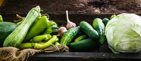 Fresh vegetables on wood.. Food layout. Vegetables variety Stock Photo