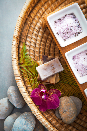 Spa and wellness. Natural bath salt and soaps with orchid flower. Spa treatment flatlay
