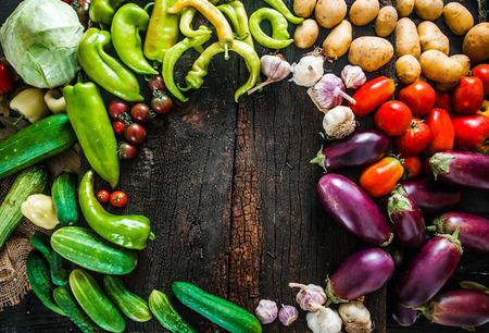 Vegetables on wood. Organic vegetables in rustic setting. Fresh food. Healthy veggies. Overhead shot Stock Photo