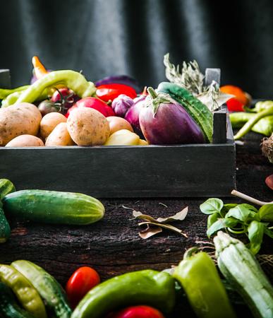 Vegetables on wood. Organic vegetables in rustic setting. Fresh food. Healthy veggies Stock Photo