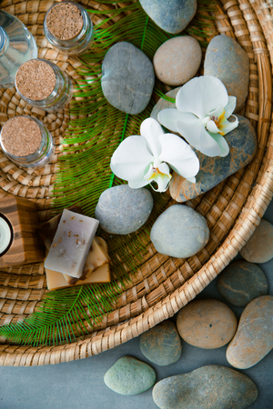 Spa and wellness. Fresh towels  with orchid. Spa treatment. Overhead flatlay Stock Photo
