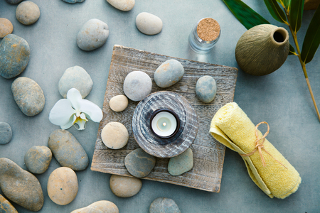 Spa and wellness. Fresh towels  with massage stones. Spa treatment. Overhead flatlay Stock Photo
