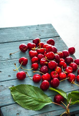 Fresh cherries on wood. Fresh organic fruit. Red cherries